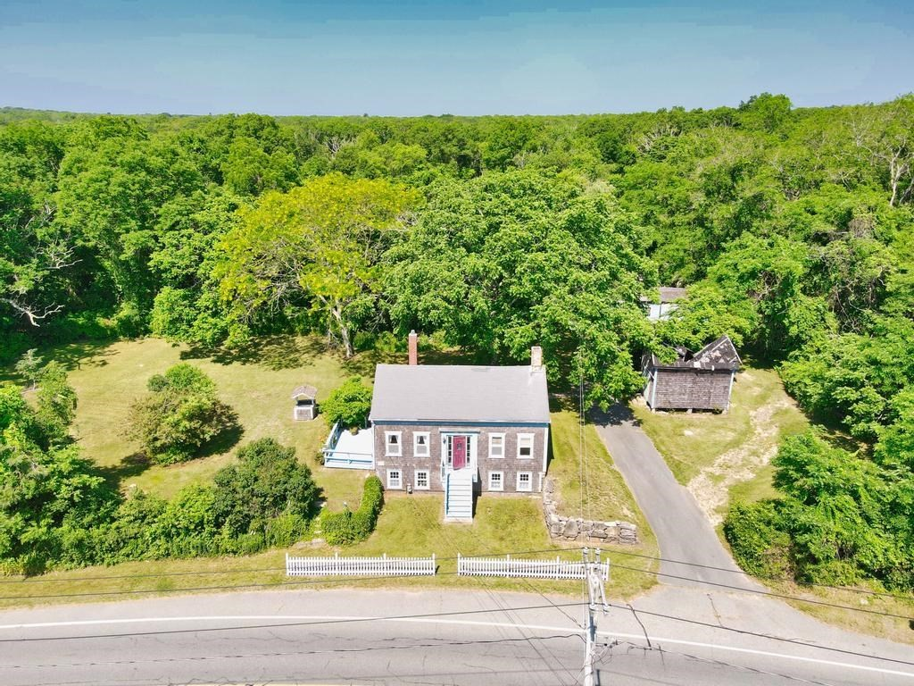 Edmund Tripp House circa 1830 - Antique Cape set on a 31-acre parcel near Westport Village. Good location for farm or possible development. Stone walls throughout the property. Close to shops, restaurants, highway access and a short drive to beautiful Westport beaches.