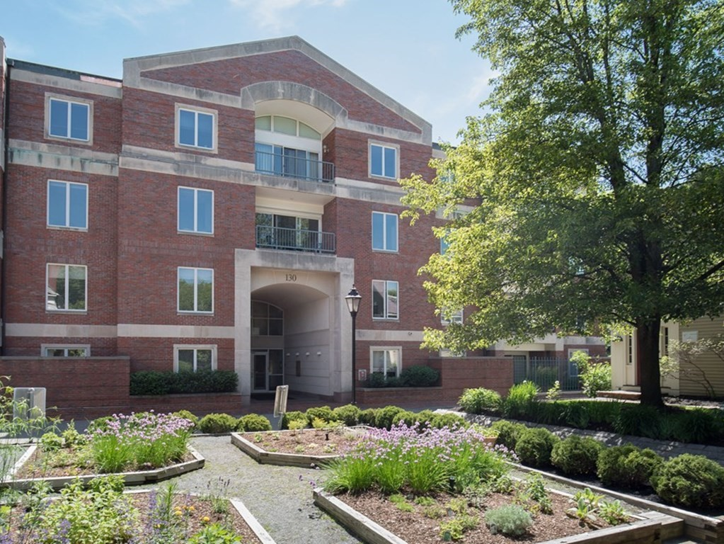 Rare floor-through one-level condominium on 3rd floor of University Green, established and very desirable Harvard Square 24-hour-doorman elevator residence. Unique for size & amenities: 4 good-size bedrooms, 4 full baths, sliding glass doors to 2 generous balconies ideal for summer meals. 2 master suites. Very generous entertaining spaces, good-height ceilings, cross-through ventilation, multiple exposures. Eat-in kitchen with lots of storage and workspace. In-unit laundry. 2 full-size garage spaces. Common flower & herb gardens, large common reception room, open landscaped inner courtyard garden. Private storage. Close to many restaurants, shops, and riverside recreation. Less than a block to the Red Line, connecting quickly to MIT, MGH, downtown Boston. Three blocks from HBS. Professionally managed. Beautifully maintained. An oasis at the heart of the city. Any offers will be reviewed Friday, July 16, at 2:00 p.m.