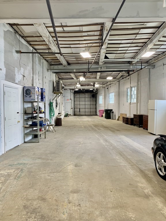 Need Great Warehouse Space?!! Come take a look at this huge heated space on Slade Street! This easy and convenient location at the corner of Barclay and Slade has 3 phase 400 amp electric ,14' overhead door, high efficiency lighting and comes with your own full bathroom and office space!  Ideal spot for contractors, electricians, plumbers , distributors or even artists who need unique space for sculpting, assembly, jewelry making and painting! (Auto repair is not an allowed use.)Please Call Today ! Easy to Show !