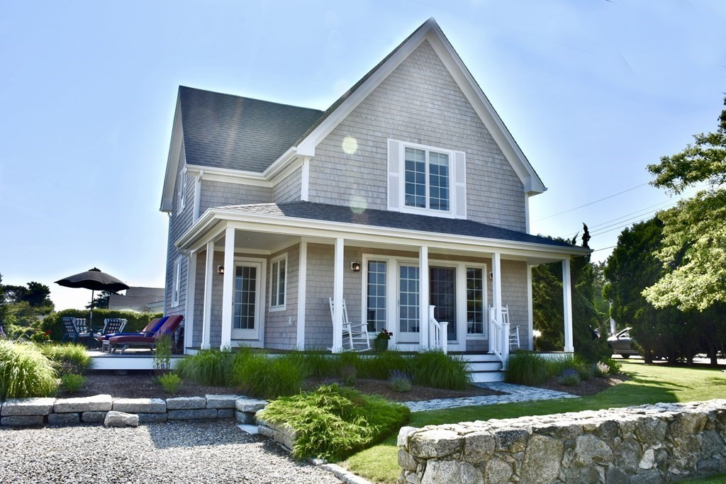 Rare find in Westport! Home has it all- incredible ocean view, wildlife, and 2 homes on one lot ! A mere 250 yds to the beach and set across the street from Allens Pond Wildlife Sanctuary which consists of  miles of trails, rare butterflies, and over 300 species of birds. Main house was built in 2008 and offers open floor plan, dark oak flooring, farmers porch, awesome outdoor shower, and breathtaking views. The guest house/cottage/rental offers 660 sqft living area, 1 large bedroom which opens to its own deck, galley kitchen, and living room. Beautiful and rare find..