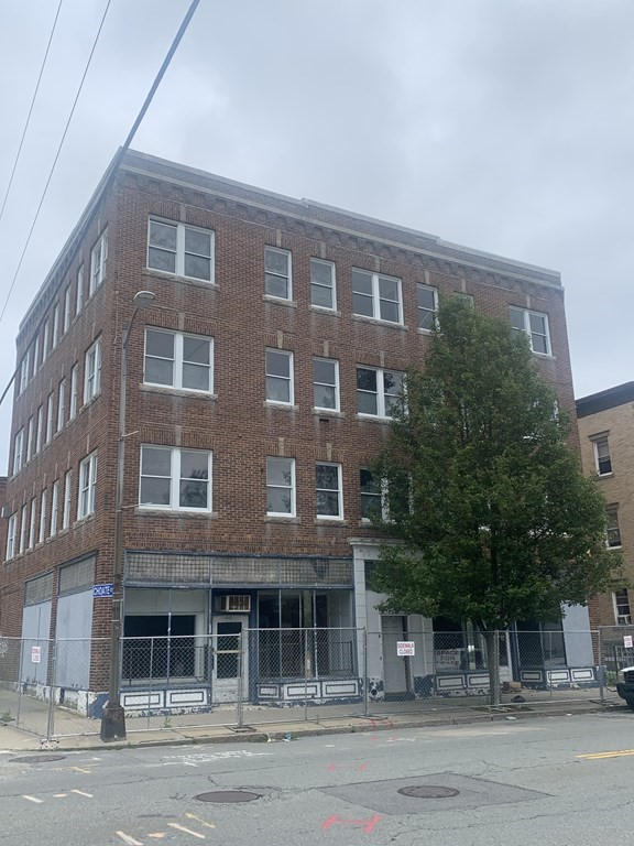 Attention Investors! Former NCR building on Pleasant Street is available! 6 large 2 bedroom unit apartments and 2 street level storefronts. Small yard in rear would be ideal for a small parking lot! This is a great opportunity to position yourself for the future!