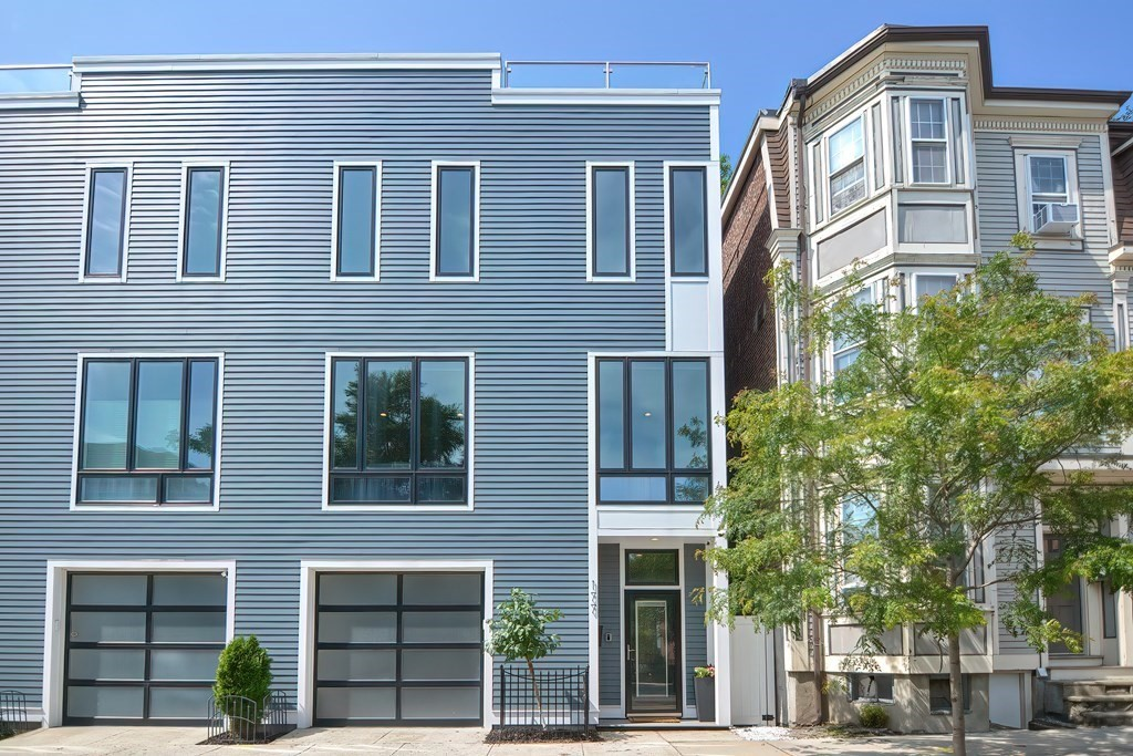 Stunning 2015 constructed single-family townhouse overlooking South Boston's new West Second Green. This 4 BR / 3.5 BA townhome features a gourmet chef's kitchen with professional grade Thermador appliances, rooftop terrace with remarkable views of Boston, drive-in heated garage, backyard patio, and built-in Sonos surround sound system. The first floor en-suite bedroom has a custom murphy bed allowing the space to be utilized as a bedroom or bonus room with direct walk-out access to the backyard patio. Living room is complete with an oversized granite gas fire place and floor to ceiling windows revealing views of the adjacent park. Third floor consists of a primary bedroom suite with a double-vanity bathroom and custom walk-in closet; along with two guest bedrooms and a guest bathroom. The roof deck - a premier place for hosting - is equipped with two urban garden beds, a water line w/ hose attachment, and a gas line for BBQ hookup. This luxury townhome is among South Boston's best.