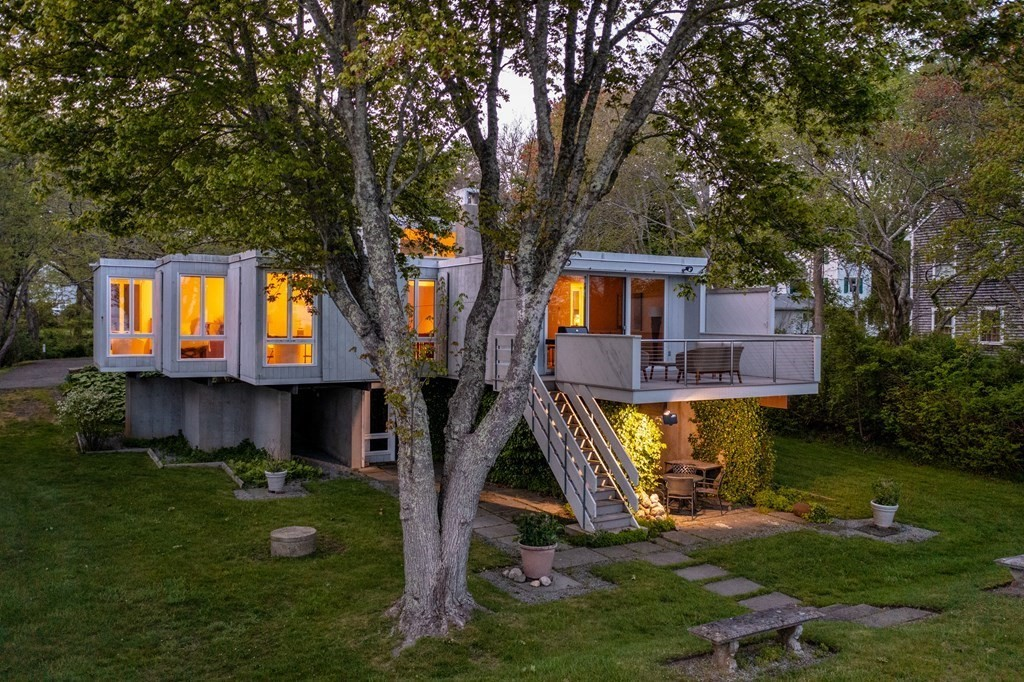 """Prominent modernist Architect Earl Flansburgh's """"Mattapoisett House"""" at 13 Shipyard Lane is a work of art. Its daring design at the time it was commissioned c.1965, in an otherwise traditional shingle-style coastal setting, represents the uniqueness of this property both in its architectural pedigree as well as its oceanfront setting on Mattapoisett's inner-harbor. Situated on a very private and breathtaking 1.37 acre waterfront lot with approximately 75 ft. of its own beach, this 1,729 sq ft, 4 BR, 3 BA residence in true modernist form was built to take advantage of its natural setting with an abundance of light and stunning views from every siteline. This home offers soaring ceilings, walls of glass, inside/outside flow from living to outside space, hardwood floors, streamlined millwork, exterior wood clad walls, and an overall elegantly simple mid-60's aesthetic. Centrally located with a 5 minute walk to Mattapoisett's charming village. This property is truly your next dream home."""