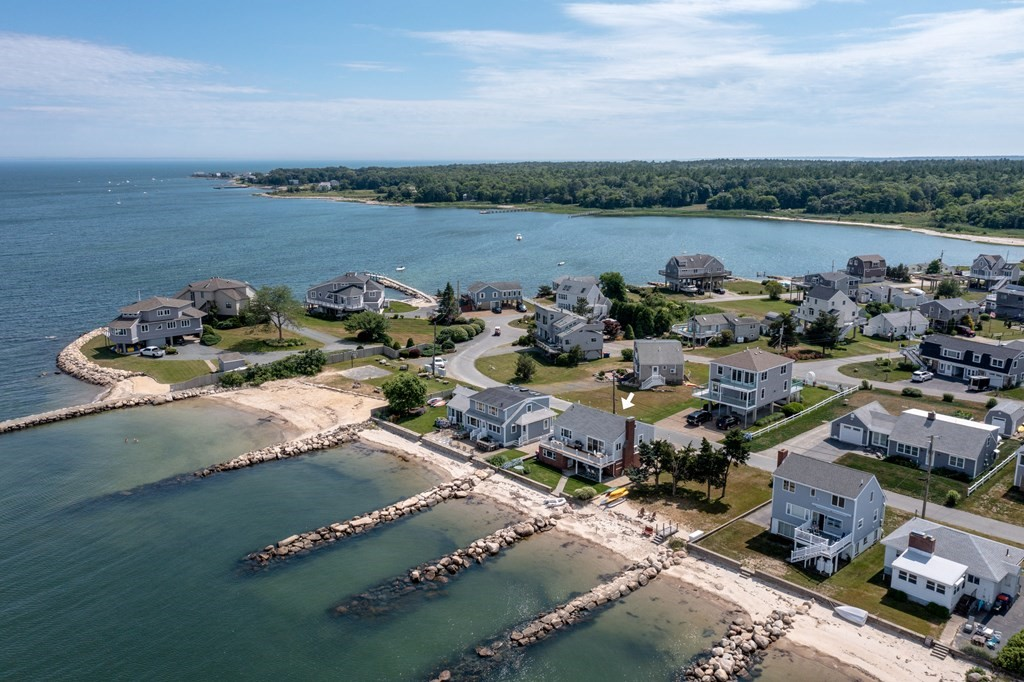 Stunning waterfront location in Mattapoisett's Harbor Beach Assoc. Enjoy every aspect of living on the ocean from swimming at your own sandy beach directly in front of your home, keeping a boat on your mooring just off-shore, or the panoramic views of Buzzards Bay, Converse Point and Bird Island looking out to Falmouth and the Cape Cod Canal. This lovingly-maintained year-round 4 BR/2 FULL BATH home has many updates including new HVAC, electrical, insulation, interior finishes, kitchen(s), bath, roof, and smart-home technology (locks, cameras, lighting, entertainment). While the upper level includes beautifully updated kitchen/living spaces open to an expansive deck, the lower level is meant for sandy feet and life on the water with its low maintenance flooring, additional entertaining kitchen/laundry area, and casual bunkrooms. This home has been in the same family for 50 years, not so unusual in this tightknit community where neighbors look out for one another.