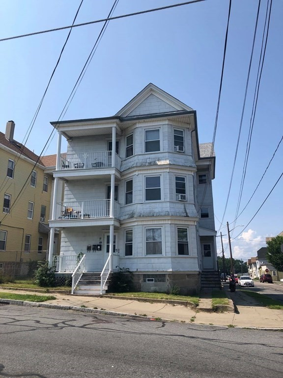 Here is your chance to invest in New Bedford. Large three family on corner lot, allowing for plenty of natural light.. Close to downtown with easy access to the highway. Each unit has pantry, kitchen/dining room, living room and three full bedrooms, as well as front porches and hardwood floors.  Newer windows and hot water heaters. Full basement with washer/dryer hookups for each floor. Fenced yard for cookouts or relaxing. Opportunity for additional income with the three car garage. Rent all three units, plus the garage, or make one your home while receiving assistance with the mortgage and expenses.