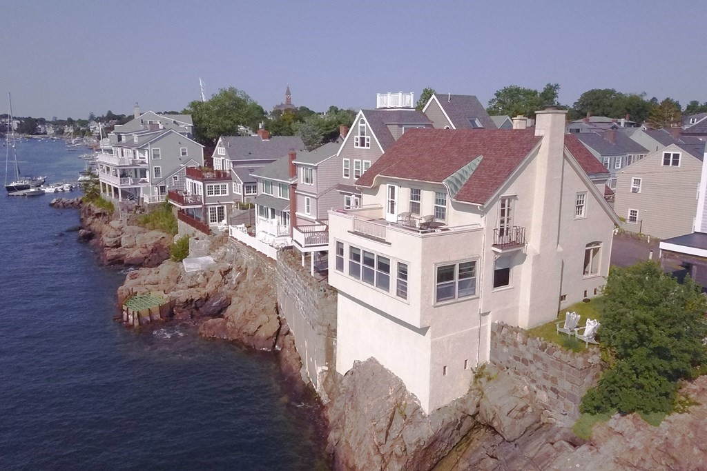 A place in the world like no other... Goodwin's Court is a remarkable small cul-de-sac with homes that perch themselves over Marblehead Harbor and bless the residents with some of the most beautiful views of Marblehead Harbor and beyond. Tucked away, off the beaten path in Marblehead's renowned Historic District, this home was built as a single-family with the current use as a 2 family. The second floor has a recently renovated owner's unit with 2 bedrooms and a spectacular deck overlooking every nook and cranny in Marblehead Harbor. Just around the corner, you can find the best that Marblehead has to offer including beaches, parks, restaurants, shopping and so much more! Roof, heat and electric services has been upgraded over the past 5 years. The property offers 2 car parking but is not a drive-by because of tight quarters.