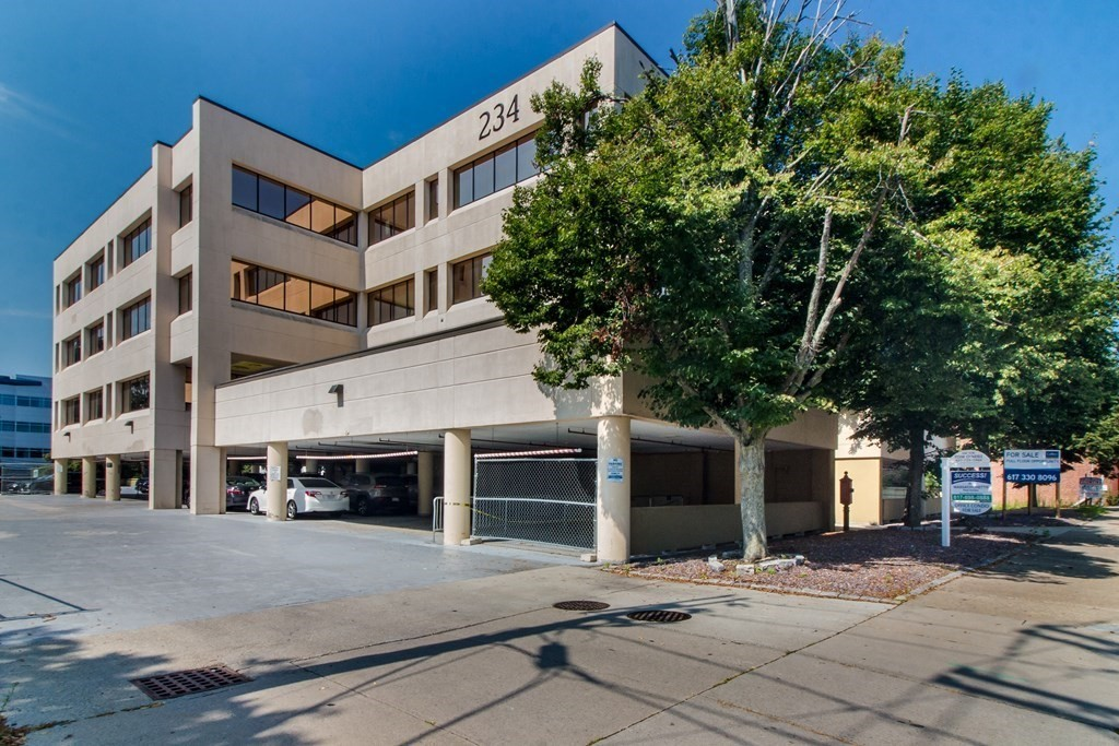 This 4,974 sq. ft. 1st class office condo is set in a fabulous location directly off I-93(Southeast Expressway) at Exit 8 and is close to public transportation with bus rt. 215 giving direct access to the MBTA  Red Line. It's just 9 miles to Boston and 20 minutes to Logan Airport. With several separate office areas, a lovely foyer and many outdoor spaces  this is an ideal opportunity for a medical office, law offices, financial/investment or any type of business. There is currently one tenant renting space at $3,000.00 per month and certainly many opportunities to increase the rental income substantially.  There are 11 private offices, a large conference room, a reception area, a kitchen, an IT area, and open work areas. there are one women's rest room, one men's rest room and one full bath with a shower stall. The building has two passenger elevators and plenty of parking. See blue square in menu bar for floor plan, 3D virtual tour, and still photography.