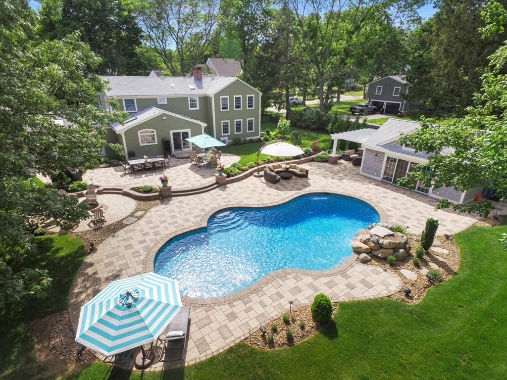 """This spectacular property showcases an absolutely amazing back yard OASIS! SHOWINGS START FRI 8/6 11-1, SUN 8/8 12-2. OFFERS DUE TUES 8/10 NOON. Sit back and enjoy your own """"garden of eden"""". Lush landscaping and a expansive multi tiered stone patio envelops a sizable free form, salt water heated Gunite pool. Invite a crowd or just keep this wonderful poolside experience to yourself. There are multiple gathering areas in the oasis for dining or relaxing. Stoke the fire pit and watch the moon rise while the kids are swimming or enjoying the professionally lite sport court. Foul weather will never end a get together here. Just move the party into the 22x22  """"tricked out"""" poolside cabana complete with fridge, wine chiller, granite countertops, lots kitchen storage, dining and media area, half bath and outdoor shower. The inside of the house is quite lovely too! Newly updated kitchen, granite counters, high end appliances, and custom cabinetry. Generous Master Suite w/ custom tile bath."""