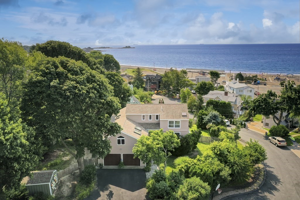 Amazing Beach & Ocean views! This contemporary home offers loads of privacy, light, space & opportunity. Panoramic ocean views & Devereux and Goldthwait beaches. Entry foyer opens to large living room w/ wood burning fireplace, tall vaulted ceilings & access to upgraded, synthetic deck w/ dramatic ocean views. Kitchen offers opportunity to personalize with plenty of room. This open layout first floor is complemented by two bedrooms with ensuite baths. The lofted second floor boasts a sitting room w/ views and an ensuite bedroom w/ its own private balcony overlooking large, private, fenced in backyard & ocean/beaches. Full basement is partially finished w/ walkout playroom and a full bath. Plenty of storage in this generously sized home, along w/ a two car garage and storage shed. Forced air heating by gas & central air offer year round comfortable living. Private dead end street offers all the tranquility of the beach & ocean without the hustle & bustle. Offer review Monday 8/9 @ Noon.