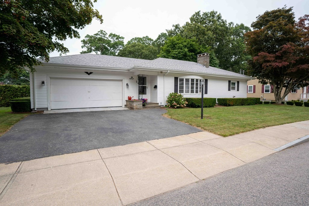 Great Dartmouth location. Lovely oversized Ranch, 2 bedrooms- master half bath & a full bath. Lovely cherry kitchen cabinets, large living room with fireplace, dining room. Central air.  Finished lower level with fireplace. Low maintenance exterior. Large 2 car garage. Fenced in yard with large deck. Call today!!