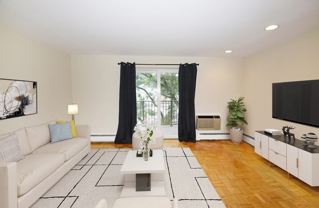 Spacious,  Sunny one bedroom unit, on third floor of the Town Lyne House Condominiums.  Professionally Managed Complex On the Brighton/Newton Town Line with on site manager. With Hardwood Floors, updated Kitchen and Bathroom, An oversized Living/Dining Room area and a Balcony overlooking the street scene below.  Lots of Closet Space in bedrooms, Linen Closet and Coat Closet in entry way.   Pet Friendly Building,  With New Elevator, New Laundry Facilities, New Pool. Minutes to Mass Pike, Downtown Boston, Chestnut Hill, BU, BC, Oak Sq Etc.    On Bus line 57-301 to Kenmore Sq .