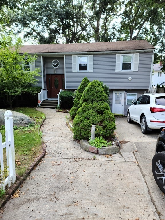 This home boasts 1130 square footage and that does not in the 1000+ square feet in the finished basement!!  This home will be 1/4 mile from the new commuter rail coming in 2023! Spacious Ranch with large bedrooms with, lots of closet space, formal dining area, large family room. This ranch comes with an in-law/apartment complete with its own entrance. Plenty of room for the extended guests, large families, and growing families. The basement offers an additional 2-3 good size bedrooms.  This home boasts hardwood floors, walkout deck, fenced in yard with a patio just to name a few!