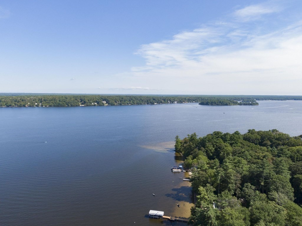 Lake Life Blessing!  Swim, Boat, Fish, Kayak, Float, or just relax at the private Association beach that's just Steps away from this rare oasis of a cottage.  This Breathtaking Water-view Lot has deeded rights to the Association beach with dock and the possibility of a PRIVATE DOCK!  Enjoy direct Lakeville Long Pond access!  A rare find in this price range.  There is an existing cottage that is most likely a tear down.  The land comes complete with a stamped engineering plan for a 2 bedroom septic design.  There is an existing septic/cesspool and well on the property, so the lot is grandfathered and ready for your building needs.   Another option would be to just fix the cottage and camp out at this lovely Lakefront community with views of Long Pond.  Enjoy full recreational deeded rights.  The Association fee is less than $300 per year which covers the private beach use and road plowing and maintenance.  Don't miss out on this amazing & affordable opportunity!