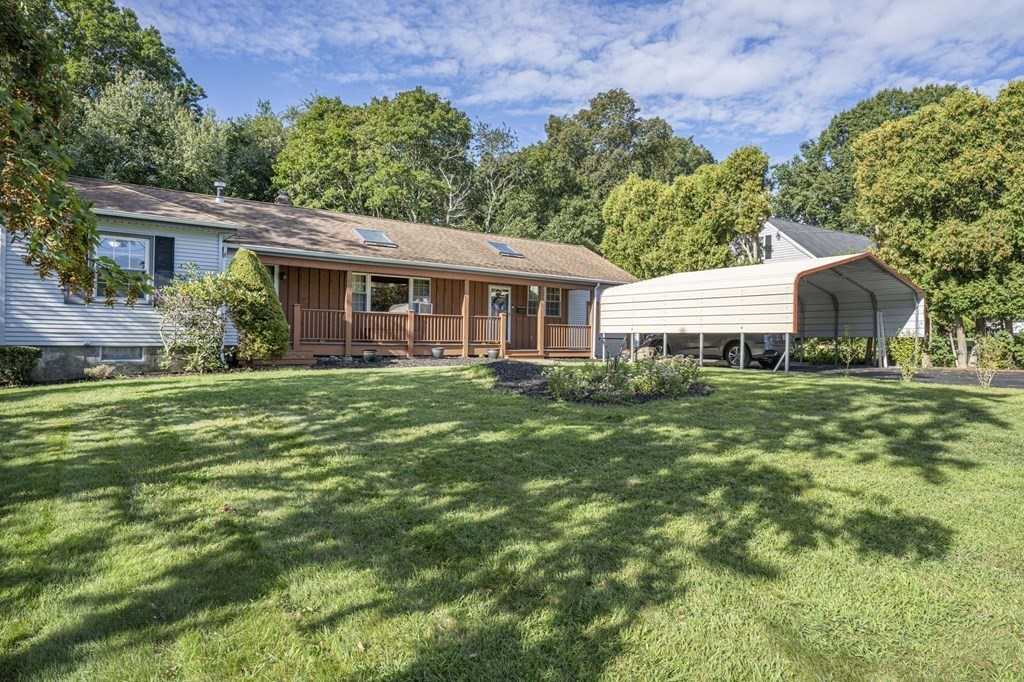 Spacious ranch close to major highways. Was a three bedroom converted to a 2 bedroom. Close to an acre of land, double wide carport and large deck. Cathedral ceilings in dining room, gas stove in living room and solar skylights. Home is very well maintained. Seller can accommodate a quick closing. First showing at open house Sunday 8/29