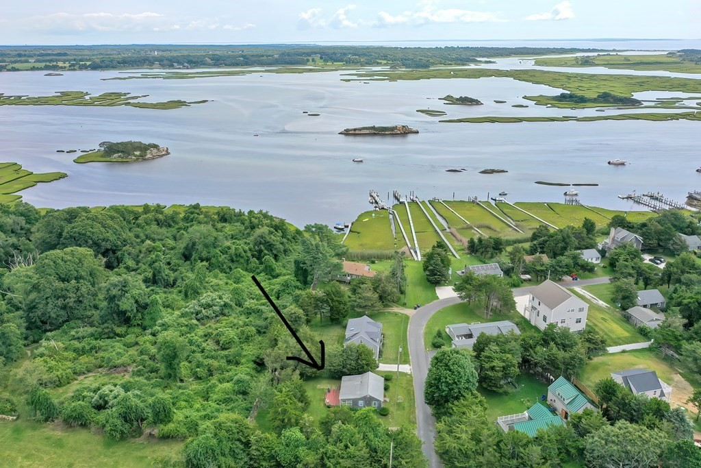 Location, Location, Location……Welcome to Masquesatch Meadows! This is a private community. This home offers deeded access to the east branch of the Westport River by shared ownership of a dock ( 4 owners total) with a spectacular view of Ship Rock. The house sits on .26 acres  which provides a storage shed and a nice sized yard with a stone wall in the back yard. This cottage style home offers one level living. Large porch area for entertaining. Title V septic inspection has passed and is a 3 bedroom design.  Easy access to the local town beaches or simply relax by the water on the dock.  This home is not in a Special Flood Hazard Area (SFHA) as designated by FEMA .