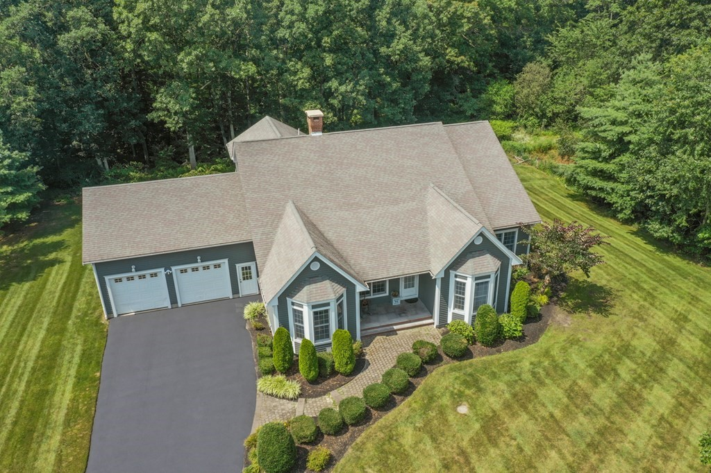 This stunning young contemporary ranch in Rocky Run Estates is nestled on a private and professionally landscaped 1.38 acre parcel on one of Rehoboth's most beautiful streets! One extraordinary feature is the flexible floor plan. Most living space including the master suite is on the first, the second features a spacious bed with full bath and the lower is finished with a billiard room, wet bar, family room and fitness center! Soaring 9'ceilings grace the main level and add to the open feel.The beautiful, finished trim and custom built-ins add to the aesthetic. A well thought-out first floor features the mud room, laundry, an expansive eat in kitchen with kitchen island, granite counters and a breakfast nook, formal dining, three beds with walk in closets and the master suite. Step out to the expansive, covered 30 x 10 composite rear porch- perfect for entertaining and enjoying the beauty and serenity of your back yard in any weather condition. This home has it all and is a must see!