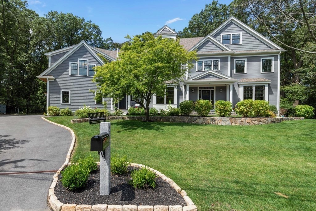 Elegant living meets modern style in this stunning Contemporary Colonial with 7,951 Sq. Ft of thoughtfully designed space over four levels. Built to exacting standards, this 6 bedroom, 7.5 bathroom home is in a class of its own, with a fabulous open floor plan, oversized windows, custom millwork and beautifully appointed spaces throughout. Sited on an impressively private 1.4 acre lot in a prime Lexington location, this pristine residence is graced with gorgeous views in all directions! Amenities include the ultimate chef's kitchen w/ stunning quartz island, fully integrated Thermador appliances, and walk-in pantry; an exquisite primary suite w/ gas fireplace and his & her closets; fantastic third floor functioning as home office space and second family room; fully finished lower level with wine closet, flexible spaces for gym, movie theatre, game room & storage; three car garage; and three season porch, opening to a beautiful mahogany deck and custom patio with built-in gas grill.