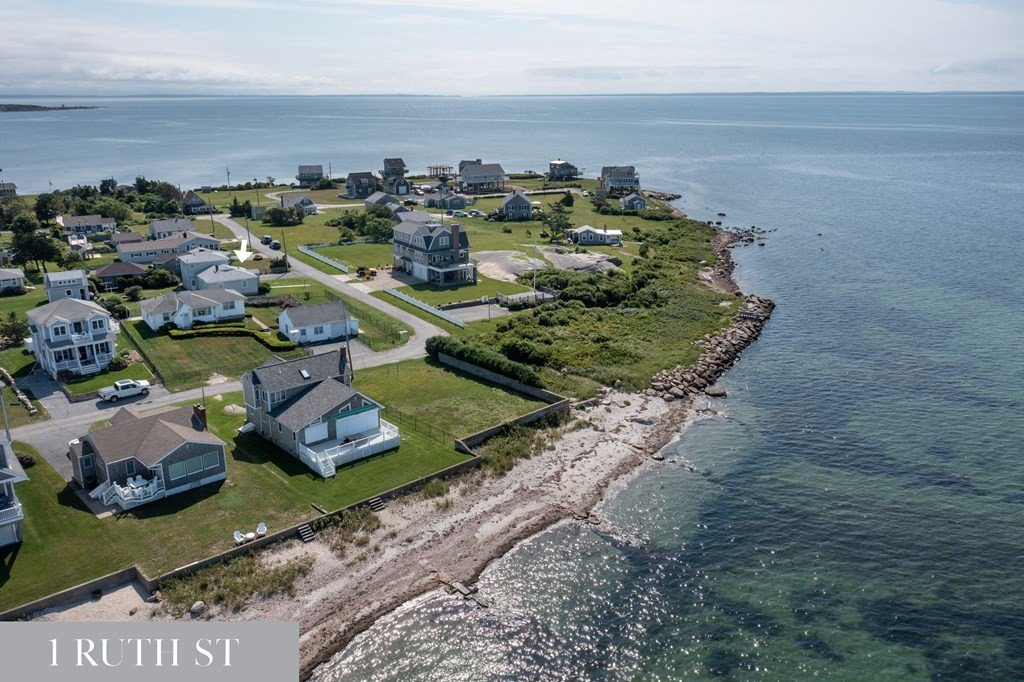 For the first time in many years this sought after Wilbur's Point location at the very tip of Fairhaven's Sconticut Neck is available for purchase. With sweeping ocean-views from nearly every vantage point, 1 Ruth St currently consists of a 3 bedrooms/1.5 bath home with a single car garage. The adjoining 39 Nelson Ave property (see 39 Nelson Ave MLS listing # 72883668) is owned by the same family and both properties can also be purchased together as a compound to potentially build your dream home. Preliminary engineering confirms allowable setbacks. All determinations are up to appropriate town department decisions. Property being sold as is.