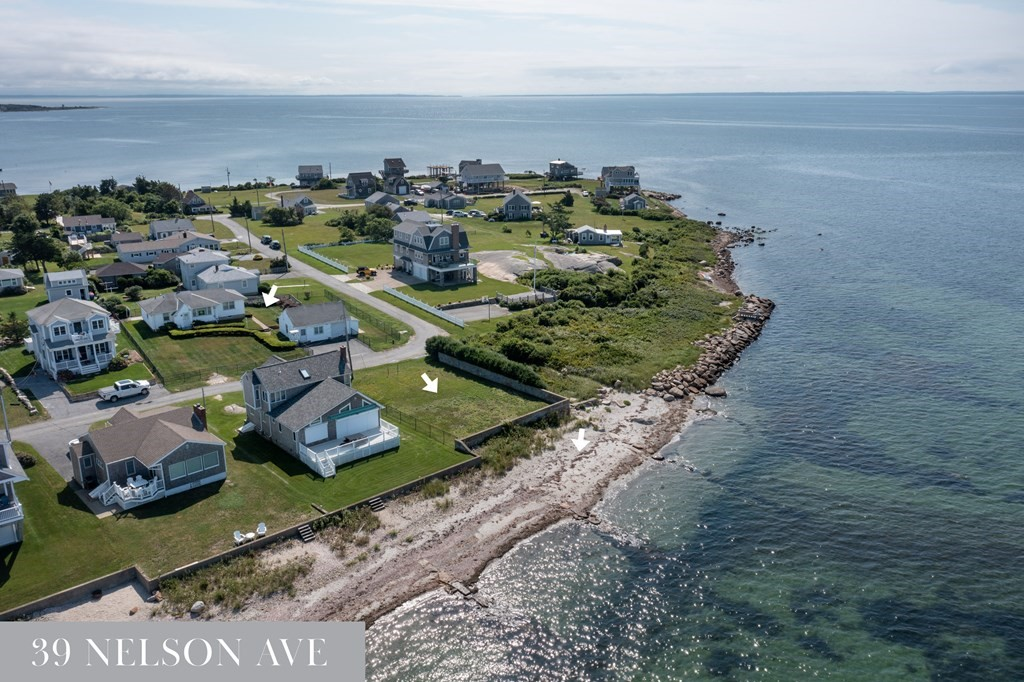 For the first time in 70 years this sought after Wilbur's Point location at the very tip of Fairhaven's Sconticut Neck is available for purchase. With sweeping ocean-views from nearly every vantage point, 39 Nelson Ave currently consists of a 1 bedroom/1 bath home with a single car garage out-building, in addition to an oceanfront lot across the street with its own sea wall and private sandy beach. The adjoining 1 Ruth St property (see 1 Ruth St MLS listing # 72883667) is owned by the same family and both properties can also be purchased together as a compound to potentially build your dream home. Preliminary engineering confirms allowable setbacks. All determinations are up to appropriate town department decisions. Property being sold as is.