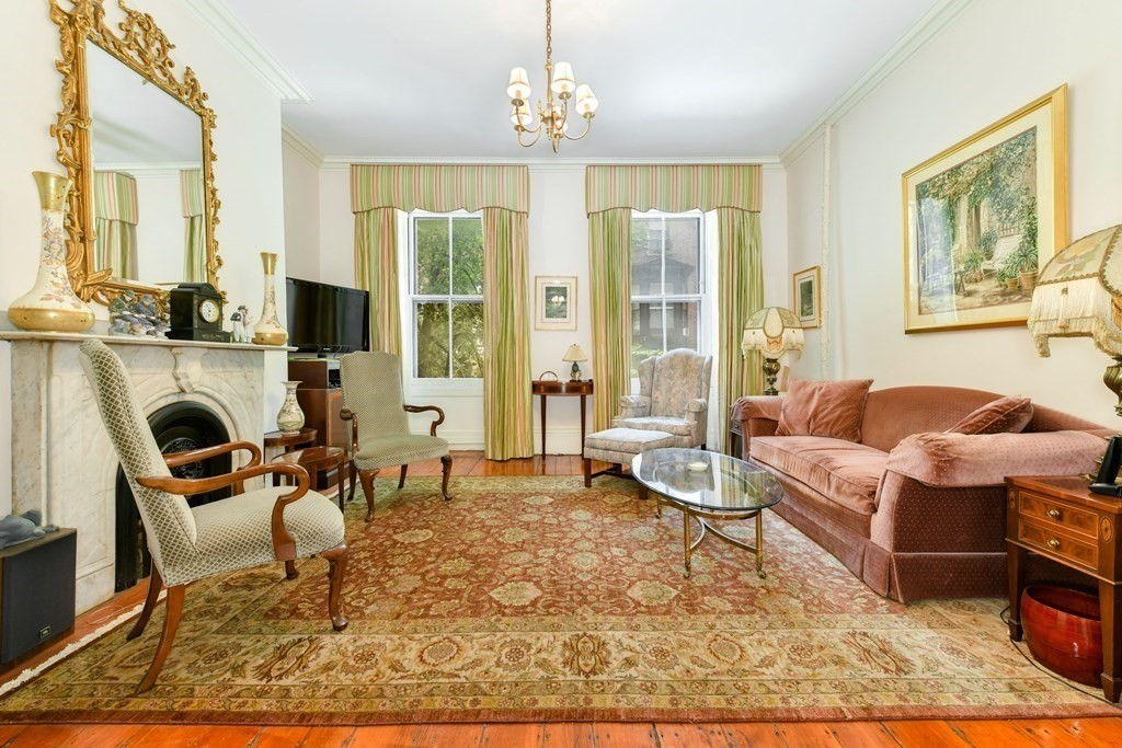Located on picturesque Hancock Street in historic Beacon Hill, this wonderful two-family residence offers five bedrooms and four full bathrooms and is classically detailed throughout six levels of living space. The gracious floor plan includes a breathtaking double parlor with high ceilings and living area overlooking Hancock Street, two eat-in kitchens, a handsome library with custom built-ins and eight fireplaces. There is direct access from the lower level into the charming, private garden terrace. The top floor loft overlooks the City from oversized windows and features original, exposed beams and ample storage space. Steps from Boston Common, Public Garden, the State House, the shops and restaurants of Charles Street and amenities such as Whole Foods, MGH and public transportation, this bit of old-world Boston is perfectly suited for 21st century living in the heart of the City.