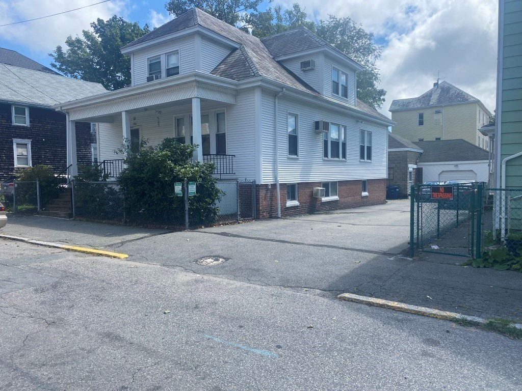 Ideal home for large family. 4 bedrooms, large living room, formal dining room, 3 full baths. Large family room with extra kitchen. Built in air conditioners. 2 large garages-ideal for contractors, landscapers etc. Low maintenance exterior. Move in condition. Call today!