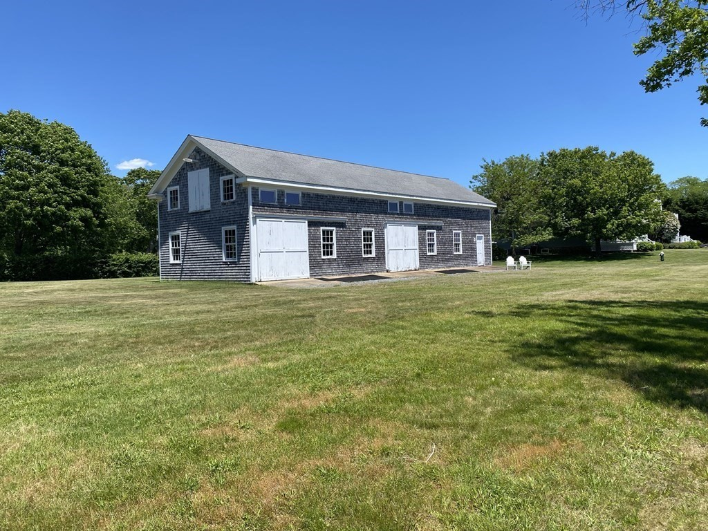 """OPPORTUNITY awaits for you in this barn/garage loft style building!! Step back into the Gilded age era and enjoy the timeless elegance, charm, history and the romance of """"Round Hill & the Mansions""""!! This Luxurious Mansion offers panoramic-views from the front of the Mansion and the Atlantic Ocean side overlooking an approximately 14 acre lawn, Buzzard's Bay & the Elizabeth Islands. The Mansion was built in 1921 by Colonel Edward Green, son of Hetty Green, better known as """" the Witch of Wall Street"""" for her fierce style as a wall street tycoon! Make your way thru the gated community and drive by the 9 hole waterfront golf course designed by Robert Trent Jones! Unwind with a game or two of tennis on the 4 Har Tru Tennis Courts!! Stop in at the clubhouse for a swim in the heated in-ground swimming pool, with lifeguard on duty! Grab a bite at the snack bar and stroll down the beautiful private walking path to the beach!! Numerous amenities at this prestigious Round Hill Community!!"""