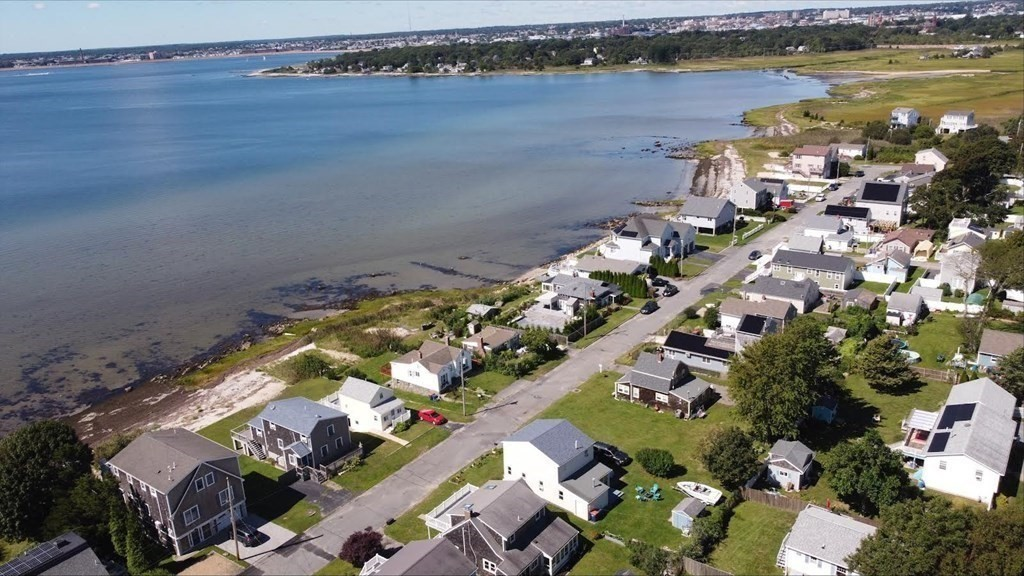 If you're looking for a well maintained, immaculate home, this is the one for you. Perfect for your year round, seasonal, or rental investment opportunity, this home is located across from Buzzards Bay. Here you'll find beautiful water views, cool ocean breezes, and beautiful sunsets. Grab your towel, sunscreen and flip flops and head to one of two public beaches, just steps away. The first floor features an open floor plan with cozy LR, updated kitchen, dining space with room for a large table, full bath, mud room with storage, pantry, and laundry. The large master bedroom has sweeping ocean views, There is one bedroom and an attached space that is suitable as a third bedroom or dedicated office space. No maintenance exterior, replacement windows. Large yard with storage shed and plenty of room to entertain and store your boat. Conveniently close to restaurants, shopping, and within easy highway access. Thirty minutes to Cape Cod & Providence, RI. Flood quote $1427