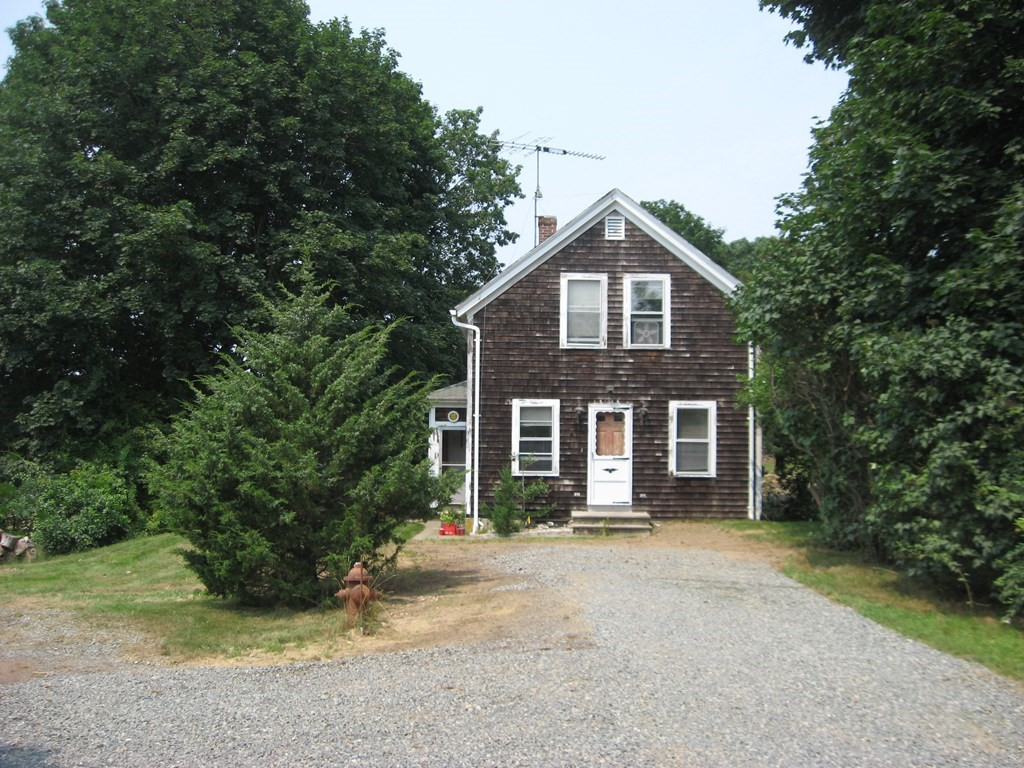 3 bedroom home in South Dartmouth in need of renovation. The house sits well back from the road on an acre of land. Large kitchen and living room with bath on the first floor, 3 bedrooms upstairs. With detached workshop and barn. There is natural gas for heat and stove and town water and sewer. Tons of potential.
