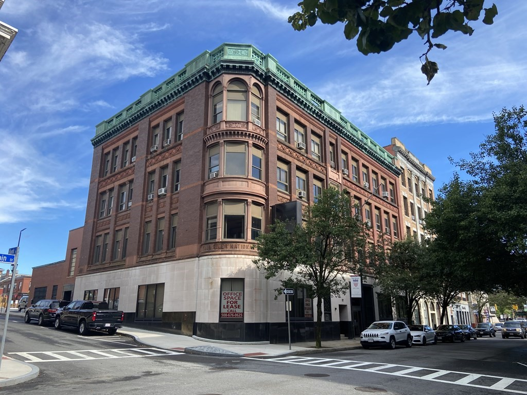 Four-story, 23,817 ± SF multi-tenant office building located on the corner of Bank Street and North Main Street in downtown Fall River. The building offers existing income from its in-place tenants along with upside potential through leasing the available space. The building was built in 1890 and includes an attractive brick façade and off-street parking in the rear.  Excellent opportunity for investors, developers, or owner/users to acquire this prominent downtown building, located in an opportunity zone.