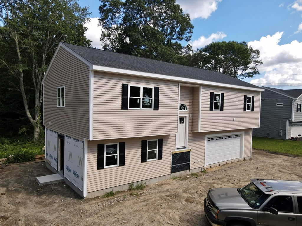 Brand New Construction on Private Roadway in the heart of Acushnet. Get it NOW! This home is open and spacious with 4 BR/3 Baths/2 Car Garage. Experience your Open floor plan... with Cathedral Ceilings in the living, dining and kitchen areas overlook conservation land and located on a private road is just what the doctor ordered. Peace and Tranquility at its finest! This small private roadway is designed for 3 single family residential homes. Full finished basement listed as 4th bedroom could easily be a fantastic home office with its own private entrance and full bath. Finished 25 x 25 Garage ample room for 2 vehicles plus storage. Video Surveillance on site-Please do not walk or enter property without listing Agent. Estimated Completion Mid-End of November 2021.