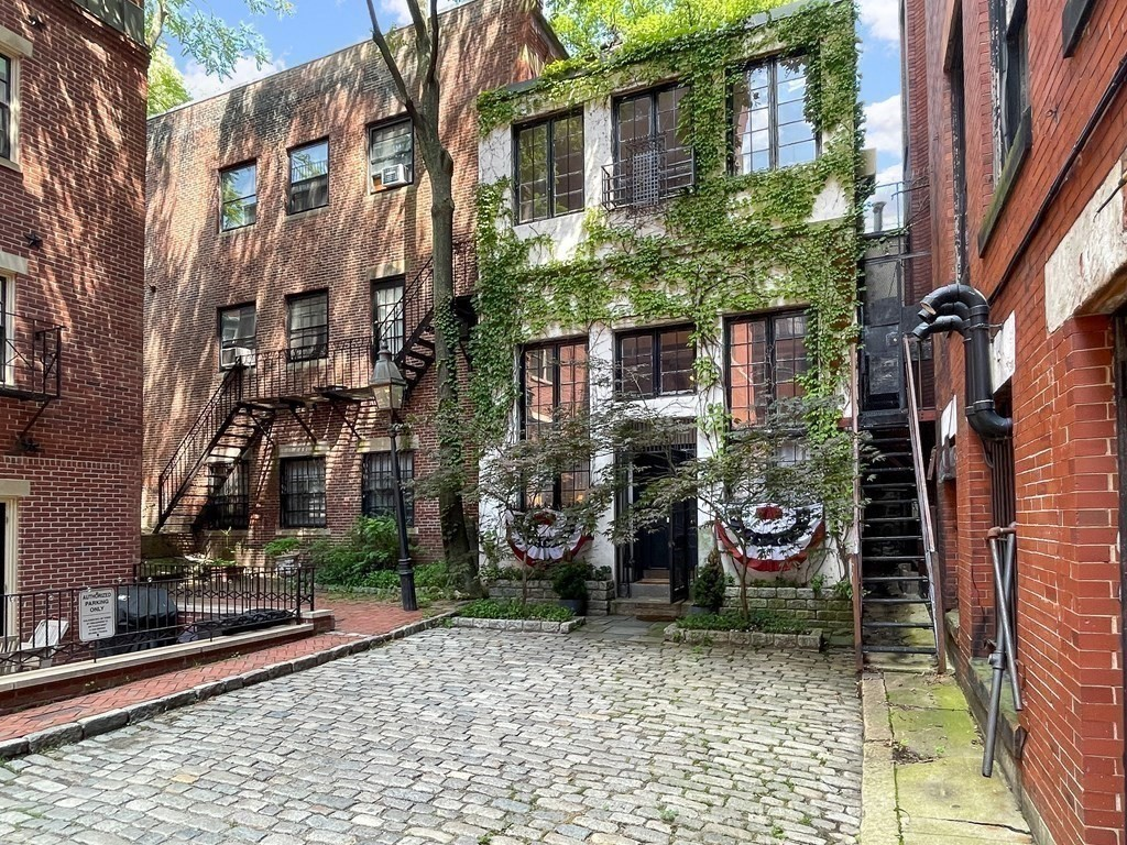 Finally, your rare opportunity to own and renovate a true one-of-a-kind Beacon Hill building. Wonderfully quirky & charming, it is being offered for the 1st time in 27 years! Superb location on a quaint, cobblestoned private way on Beacon Hill's desirable South Slope. This unique property has phenomenal design potential - bring your imagination and your favorite architect. You'll love the gated entrance, soaring 15 ft ceilings & fabulous windows overlooking beautiful courtyards front & back. 8 Spruce Court was built during the expansion of a Beacon Street Club to be their squash court. It is currently configured as a 2 unit building. The architect we showed it to, saw the greatest potential as one space, perhaps with a fabulous master suite on the top floor. What will you turn it into? Your unique city home/pied-a-terre? Expansion space for the things you love to do? Live/work space, customized for working from home? Start imagining the unique and special space you could create here!