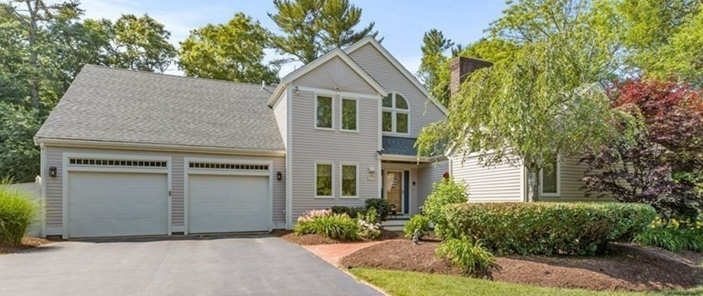 Sunny and cheerful, comfortable and cozy,  yet incredibly roomy - this 4BR/4.5BA house has it all.  Plenty of room to enjoy entertaining with space to retreat to your own room for work, rest or play. Modern updated kitchen open  to fireplaced family room with sunny solarium used as a breakfast nook that also leads to a separate bonus room with full bath - this could be a guest suite, home office, au pair suite,  whatever you decide! Beautiful fireplaced living room open to dining room, with wet bar and 2 sets of French doors. Step out to a sunny deck or to the fully enclosed screen porch. First floor master suite with fireplace, gorgeous bath and double closets. First floor laundry room and half bath. 2nd floor has 3 large bedrooms, 2 full baths and loft area used as a library/office space.  Situated on nearly an acre lot set back with deep frontage, large fenced in yard and a 2 car attached garage.  Attic storage and full basement.  2 yr. old roof and new 4 bed septic.