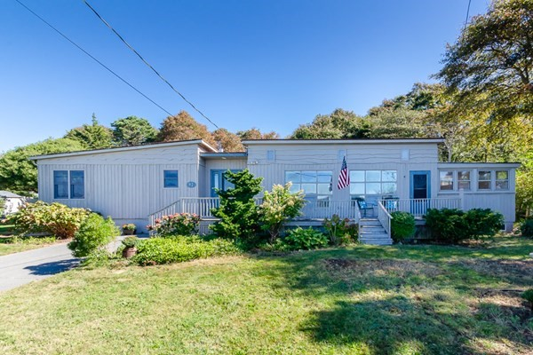 Lovely one-level seaside home in picturesque West Island with beautiful water views, beach access, and an expansive two-stall garage with unfinished loft space.  This beautiful property has been lovingly nurtured for decades by the same family, and now we are proud to present it for sale.  97 Balsam Street features lovely perennial gardens, three bedrooms, 1600 square feet of living space, screened in porch, and an over half acre lot stretching out to Cottonwood Street.  Expanded in the early 2000's, the home features a roomy one-level layout including a laundry room, bonus rooms, and open floorplan with cathedral ceilings.  For those seeking their West Island home, this delightful coastal property is a must see.