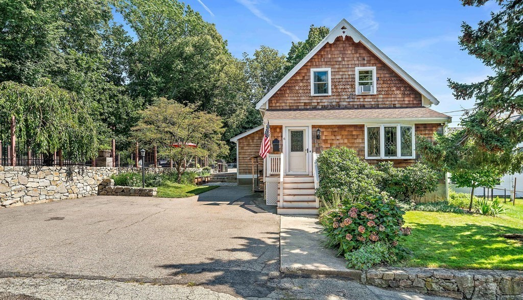 Enjoy privacy and space in this Hull Village home, which is out of the flood zone and is walking distance to the beach, ferry, elementary and high schools, library, and playground. Recent renovations include a wood stove insert and chimney (2020), 50-year warrantied roof (2018), and a custom kitchen (2020) with a gas range, double drawer dishwasher, inset cherry cabinetry, granite countertops, water filtration, walnut flooring, and more! Enjoy an immersive outdoor experience through the built-in fire pit and cobblestone patio (2020), cedar pergola (2020), Trex decking, and beautiful pool and patio (2017). Harvest food and flowers from apple trees, blueberries, seedless grapes, raised bed gardens, custom chicken coop, bee hives, and the hundreds of flower bulbs and perennial plants throughout the yard. The sellers are happy to convey their property survey (2016), insight for an attached garage with main floor laundry, and any other information to help make 6 Cushing Street your home!