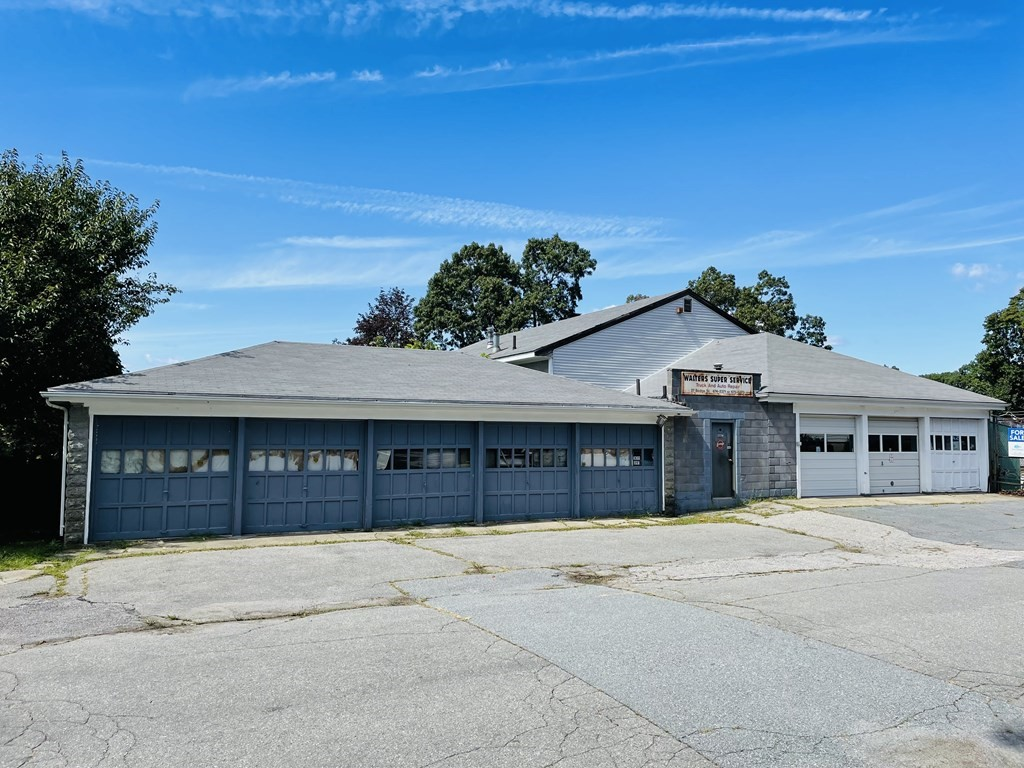 So much potential with this oversize commercial concrete block building with 11 bay garage set on about 1 acre of land with large parking lot! It was formerly a repair garage for many years just off of Eastern Avenue with potential access from Eastern Avenue or utilize the dead end off of Bedford Street. Please allow 24 hour notice to show.