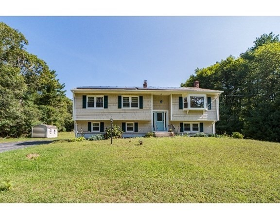 Fantastic opportunity to live in Dartmouth!  Privately set across from the 280-acre Destruction Brook Woods conservation land, this 3 bedroom, 2.5 bath raised ranch has an open floor plan, hardwood floors, loads of natural light and over an acre of land.  On the main level, there is a large living room with a bay window, a granite kitchen with large eating area and three spacious bedrooms.  The master bedroom has a walk-in closet and its own bath.  Downstairs is a huge family room with kitchenette, a half bath and bonus room - perfect for in-laws or a home office.  Enjoy al fresco dinners on the deck, or by the above-ground pool.  New roof in 2017 and newer boiler and hot water tank. There is nothing for you to do but unpack and enjoy all that Dartmouth has to offer, including local shopping and the lovely nearby village of Padanarum.