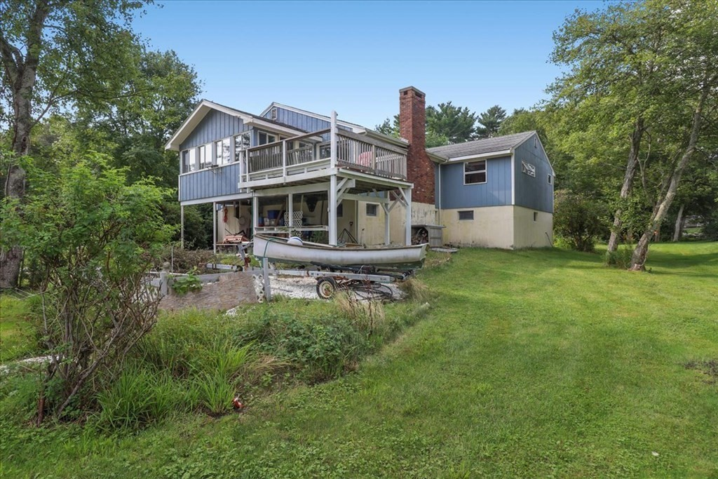 Location! Location! Location! Waterfront property in Marion for under a million dollars. Attention water sports enthusiasts don't miss out on this one. Enjoy boating, water skiing, canoeing, kayaking or just simply enjoy the beautiful views of the Weweantic River and the gorgeous sunrises. Take a stroll down to the private beach and enjoy a glimpse of Cape Cod from afar without dealing with the traffic. This 3 bedroom, 2 full bath home sits on three lots with 240 sq ft of frontage on Bass Point Rd. The large fieldstone fireplace living room, dining room, master bedroom, kitchen, 3 season room and deck offer clear water and nature views, all for under $800,000.   Recent roof on main house. Boat ramp within feet away. Outdoor shower. Raised foundation. Ample parking for boats or RV's.