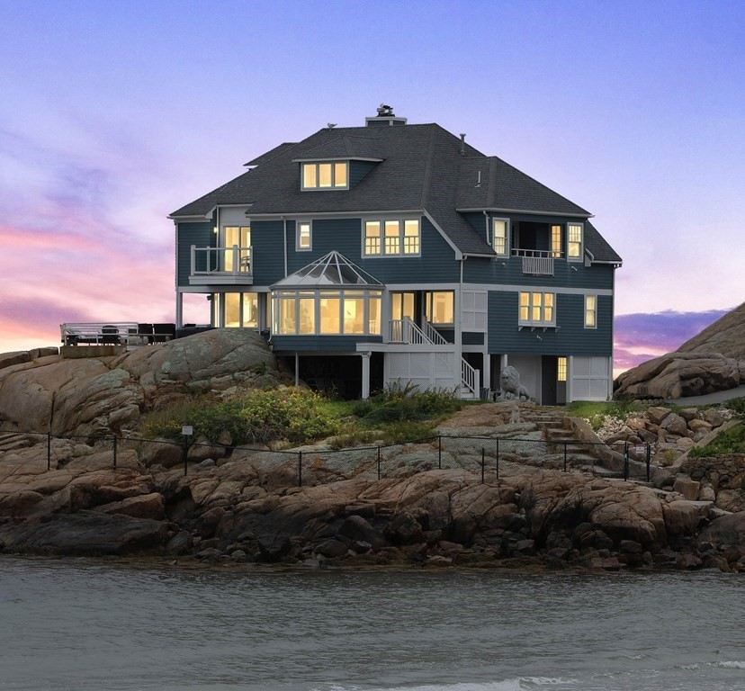 """""""HIGH ROCK""""- OPEN SAT 9/25 12-2.An iconic Beachfront/Oceanfront year-round Contemporary, prominently set on the landmark pinnacle of Brier Neck and overlooking the pristine sands of Long Beach.Enjoy the best of both worlds surrounded by incomparable ocean frontage and private walkway to a world-class sandy beach.Wrap-around walls of glass magnify the expansive panoramic views of the Atlantic Ocean,Twin Lights, and sweeping coastline.This newly renovated, custom designed chef's kitchen is thoughtfully equipped with all new high end appliances, a large center island, fireplace and indoor grilling all with ocean views.A glass atrium protrudes out over the beach side of the house and a wrap around deck connects to the ocean side. The luxurious Master suite boasts a state-of-the-art custom spa bath, fireplace, a private balcony and commanding ocean views .Each additional bedrooms has its own unique water view. Enjoy private access to one of the most beautiful sandy beaches on the East Coast"""