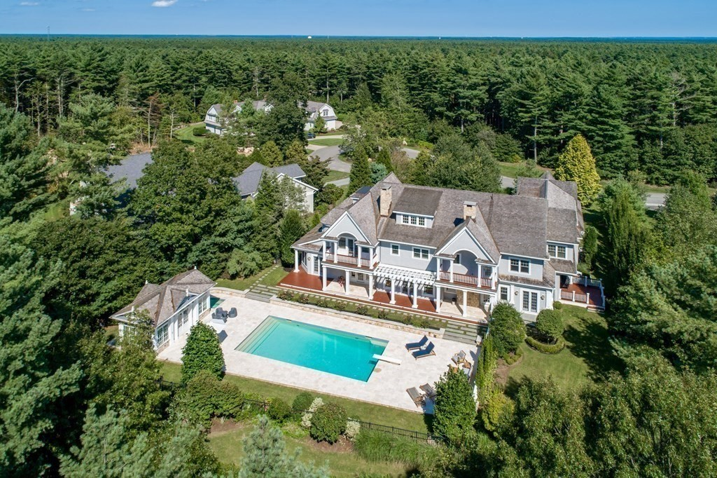 Located in the Bay Club of Mattapoisett, this spacious 10,000 sf. estate is the ultimate in living well. Built by Bishopric Builders, amenities abound in this custom home to include a saltwater pool, pool house & hot tub, lushly landscaped grounds with specimen trees, gym & sauna, bowling alley, three wood burning fireplaces, six bedrooms, ten bathrooms and two staircases to access the four levels of living space. The first floor offers a gourmet kitchen with top of the line appliances that overlooks the family room with wood burning fireplace, a butler's pantry, formal dining & living room, two offices, a sunroom, and a den with wet bar. French doors span the rear of the house opening onto the bluestone patio and pool. The 2nd & 3rd floors include a primary bedroom suite with balcony overlooking the pool, his & her bathrooms and walk in closets. The remaining five bedrooms are all ensuite. Entertainment space spans the lower level where you can play pool, putt & candle pin bowl.