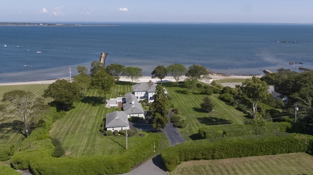 Quintessential New England waterfront estate perfectly situated on almost 3 acres & nestled on Mattapoisett Harbor. Almost 300' of private beach frontage with multiple mooring opportunities and direct access to Buzzards Bay, no bridge traffic. The estate has been family-owned over 80 years and meticulously cared for throughout generations. The main house boasts 4 bedrooms, 3 full & 2 half baths. Stunning water views from the picture windows in the living room, upstairs bedrooms and generous outdoor deck and patio. Spacious play room with plenty of space for ping pong, lounging and pool. Oversized, multiple-car garage and plenty of outdoor parking. The manicured grounds are completely private with lush landscaping and expansive side yards, perfect for outdoor summer entertaining. Enjoy fishing off almost 500' pier, swimming and all types of boating.Unique Opportunity.