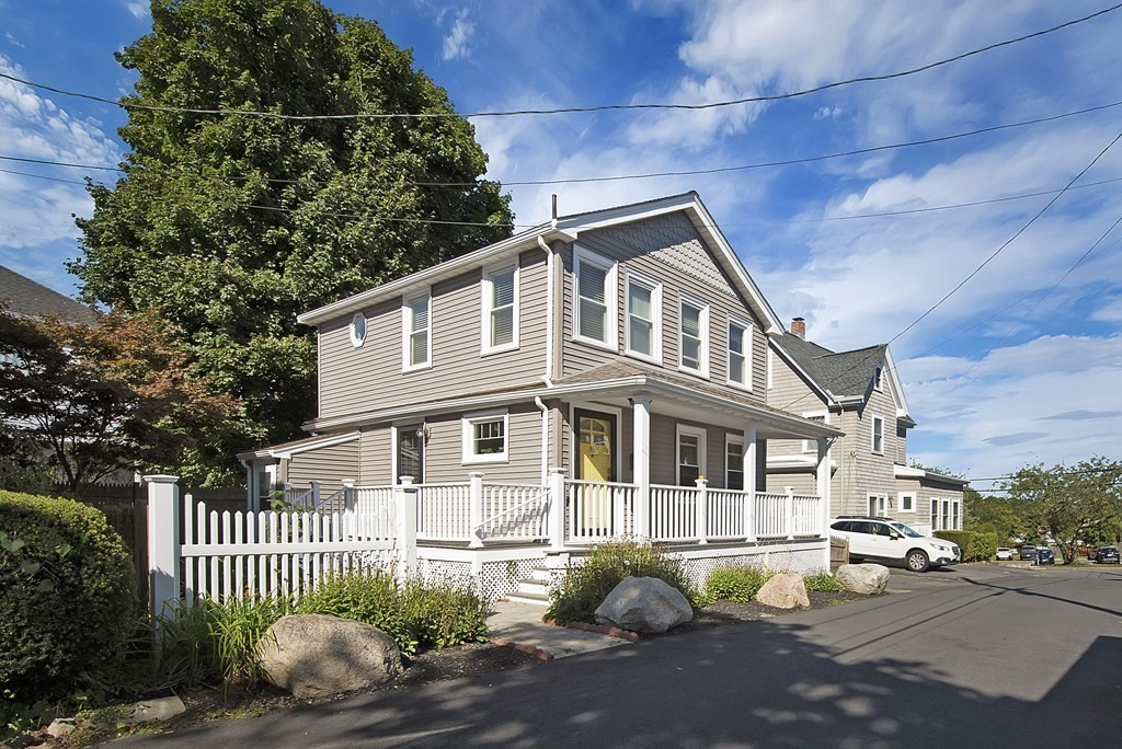 """Imagine Coastal living in the quaint seaside town of Nahant!  Feel the sea breezes, see and smell the ocean from the front of the property. This well-located fully renovated home is yards to Johnson Elementary/Playground, .03 M to beach and public golf course, at the end of Maple offers a view of the ocean & Boston Skyline. The property is """"Turnkey"""" with updates including maintenance-free siding, windows, roof, composite deck/rails, fencing, lighting, newer boiler, a/c & tankless water heater, a generous deck and patio & 4 car parking. You will love the light and decor this cozy home offers featuring a neutral Seascape color palette, charming moldings, gleaming hardwood modernized with an open-concept, fully-applianced Kitchen/Dining area; baths, flooring, A/C splits, lighting & more.   Nahant is a close-knit quiet Peninsula surrounded by beaches and boating; offering many activities, reasonable taxes & several commuting options. 7 Maple welcomes you for a Summer or Year-Round escape!"""
