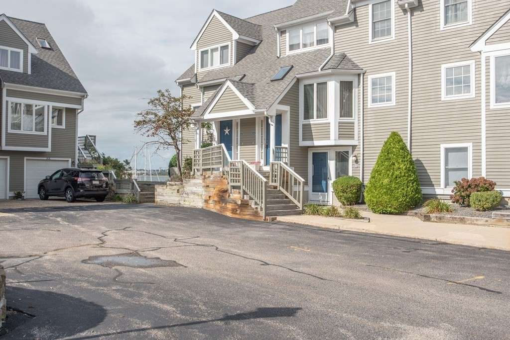 Enjoy spectacular water views from this sun filled, waterfront townhouse at The Landing!  The 1st level boasts a nice open floor plan with eat in kitchen, dining area, living room with wood burning fireplace, half bath & sliders to your deck overlooking the marina & Taunton River.  On the 2nd level, you will find 2 large bedrooms - each with their own private bath.  Lots of closet space & storage.  The master bedroom has it's own private balcony where you can enjoy the perks & views of waterfront living. The condo includes a garage & space for an additional vehicle.  The complex is professionally managed, and the grounds impeccably kept.  This condo is steps away from the in ground pool and club house which has a work out room, sauna & meeting space. Minutes from highways, public parks, private & public schools, hospitals etc.  Don't miss out on this one!