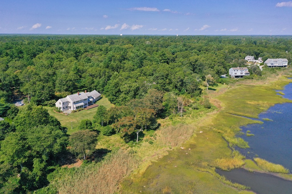 Spectacular waterfront property just outside of Marion Village overlooking Stewart Island, outer Sippican Harbor and Buzzards Bay.  Tucked away down a long, winding drive is this private, waterfront sanctuary set on 8.61 acres. The 3,700 +/- square foot home offers an inviting floor plan with great flow and open spaces. The large chef's kitchen boasts two islands, top of the line appliances, and a butler's pantry. The open floor plan ties the kitchen into the dining area, sunroom, and living room with fireplace. Also with a first floor study that could serve as a bedroom, laundry and utility room, 2 car garage, and expansive deck. The second floor offers 4 spacious bedrooms, including a master suite, 2 bathrooms, and an office space. This home was thoughtfully built to showcase the dramatic views of the marsh and the bay from every room. This is truly a rare waterfront offering.