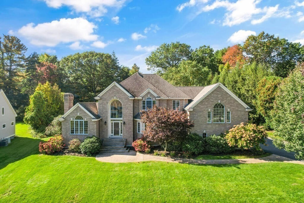 Stunning Custom Brick Colonial on sought after Cul de Sac Close to Highways & Downtown! Gorgeous, Professionally Landscaped Lot features Scenic Pond & Private Stone Patio with mature plantings. Gracious Two Story Foyer with Elegant Staircase welcomes you Home! Open Concept with Great Flow-Perfect for Entertaining! Relax by Living Room Fireplace & Enjoy Beautiful Views! Beveled Glass Pocket Doors to Office with Custom Built-ins. Sunken Family Room with Floor to Ceiling Stone Gas Fireplace flanked by 2 French Doors leading to Beautiful Backyard. Dream Kitchen loaded with Custom Cabinets, Large Island, Breakfast Bar, Oversized Eating Area & Desk. Laundry & Powder Room complete 1st Floor. Rear Staircase to Mid-Level Private Master Suite boasting Tray Ceiling & Large Windows with Gorgeous Views. Spa Like Master Bath with Tiled Steam Shower, Jetted Tub & Double Vanity. En-Suite Bedroom with Private Bath. 2 Add'l Bedrooms & Full Bath complete 2nd Floor. Lower Level Gameroom with Pool Table.