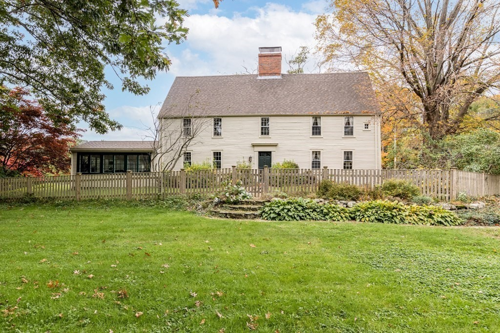 """The James Noyes House c 1646 is one of only ten intact first period homes in Massachusetts.  Enter the gate and you will immediately know you are in a very special home. The features are truly amazing from the summer beams with """"lambs' tongue"""" detailing to the wide """"kings board"""" floor and wonderful fireplaces, moldings and paneling; the charm and history are unsurpassed. The room proportions are impressive with many rooms over 18x20 feet. The current owners have lovingly maintained and updated with deference to the period; but with an eye to modern livability adding a stunning 19 x 34-foot sunroom with brick floors overlooking the pastoral grounds. With 2 staircases the flow for circulation is very good. Updated in the 1729/1800 and 2020 this is a warm and cozy house with surprisingly high ceilings, it was clearly built by a family of means. The two-car garage with office suite with bath above completes this landmark property."""