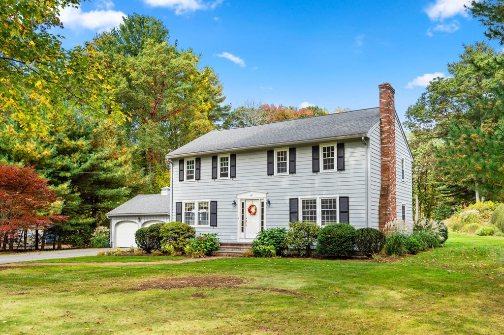 Move right in to this meticulously maintained home, boasting all the charms and amenities of a classic New England Colonial in the Sargent School District. Featuring a gracious entryway, navigate seamlessly throughout this fluent floor plan featuring hardwood floors, a fireplace surrounded by custom built-in shelving, and a bay window in the dining room. The first floor features a spacious, eat-in kitchen, two living areas, a half bath and main level laundry. Head on upstairs toward the master suite, complete with an over-sized closet, and a master bath. Three additional large bedrooms & a full bathroom, complete this level. Outdoors, your own sanctuary awaits - offering over an acre of lush green foliage. Enjoy the privacy of an oversized backyard great for entertaining and relaxation. Conveniently located within minutes from shopping and restaurants, local schools and close proximity to 93 & 495.